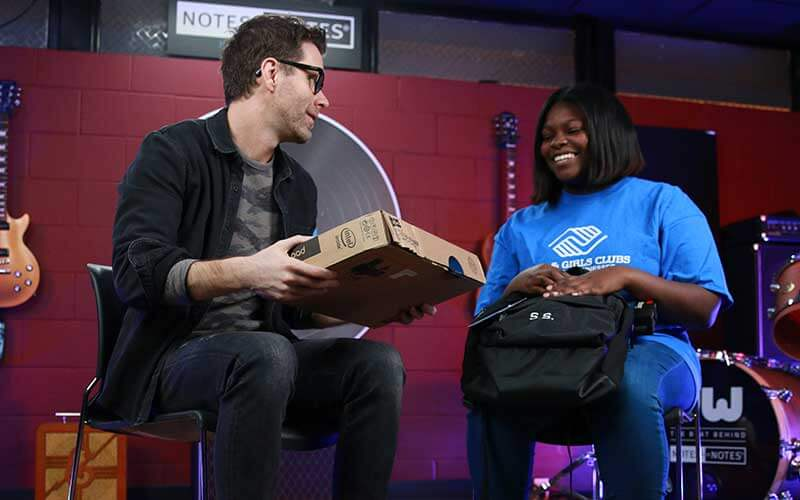 Bobby Bones and woman smiling